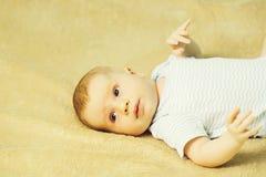 Cute baby boy in romper stock photos