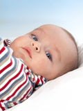 Cute baby boy with blue eyes Stock Images