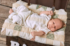 Cute baby boy. Caucasian child lying on blanket Stock Photo