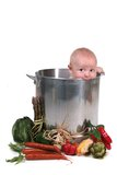 Cute Baby Boy in Chef Pot. With Vegetables on White Stock Photo
