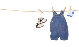 Cute Baby Boy Clothes Hanging on a Rope Royalty Free Stock Photo