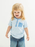 Cute baby boy cries Stock Image