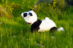 Cute baby dressed in Panda bear costume in summer park. royalty free stock photography