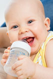 Cute baby boy drinking water from bottle Royalty Free Stock Photography