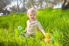 Cute baby boy with Easter eggs royalty free stock photo