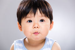 Cute baby boy eating biscuit Royalty Free Stock Image