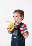 Cute baby boy eats banana. Stock Images