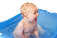 Cute baby boy enjoying his bath Stock Image