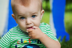 Cute Baby boy with finger in his mouth Stock Photo