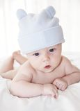Cute baby boy in a funny blue hat Stock Photography