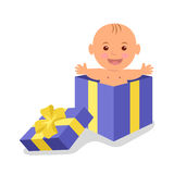 Cute baby boy in a gift box. The precious gift of life Stock Image