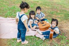 Cute Baby Boy and Girls 2-3Year Old play on Picnic Blanket stock images