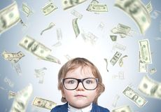 Cute baby boy in glasses and dollar rain Royalty Free Stock Image