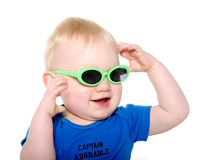 Cute baby boy with green sunglasses Stock Photos