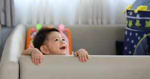 Cute baby boy happy in living room with soft pad mattress partition protection in family home stock video