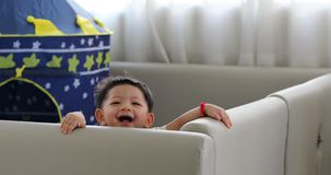 Cute baby boy happy in living room with soft pad mattress partition protection in family home stock video footage