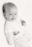 Cute baby boy. Happy cute newborn baby smiling looking at the camera Stock Image
