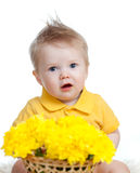 Cute baby boy holding basket with yellow flowers Stock Photography