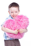 Cute baby boy holding a heart. Fur and pink Royalty Free Stock Photos