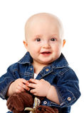 Cute baby boy holding toy bear Royalty Free Stock Photos