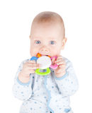 Cute baby boy is holding toy Royalty Free Stock Photography