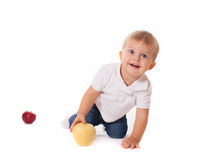 Cute baby boy kid playing with apples Royalty Free Stock Photo