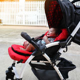 Cute baby boy laughing happy in child stroller Stock Images