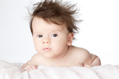 Cute baby boy with long hair. Royalty Free Stock Image