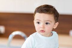 Cute baby boy looking away. Close-up of cute baby boy looking away at home Royalty Free Stock Images