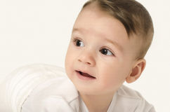 Cute baby boy looking to the side. Stock Photo