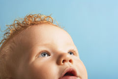 Cute Baby Boy Looking Up Stock Photo