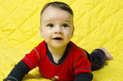 Cute baby boy looking up curious. Stock Images