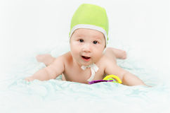 Cute baby boy. Lying on the bed Royalty Free Stock Images