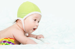 Cute baby boy. Lying on the bed Royalty Free Stock Photo