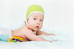 Cute baby boy. Lying on the bed Royalty Free Stock Image
