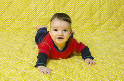 Cute baby boy lying on his belly. Stock Photo
