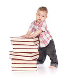 Cute baby boy with many books isolated on white Royalty Free Stock Image