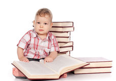Cute baby boy with many books isolated on white Stock Photography