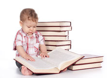Cute baby boy with many books isolated on white Stock Photos