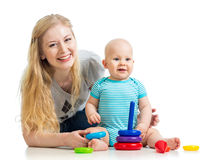 Cute baby boy and mother playing together Royalty Free Stock Images