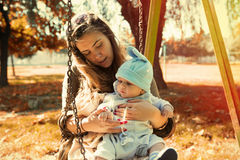 Cute baby boy in mother sitting outside the nature Royalty Free Stock Photo