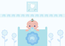 Cute Baby Boy in Nursery. Cute baby boy in his crib with a nursery bedroom background Stock Images