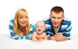 Cute baby boy with parents Stock Image