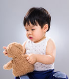 Cute baby boy play with doll Royalty Free Stock Photos