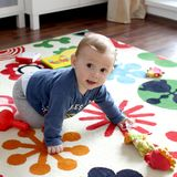 Cute baby boy on play mat royalty free stock images
