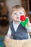 Cute baby boy playing with basket Stock Photography