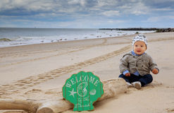 Cute baby boy playing with beach toys Royalty Free Stock Photo