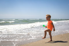 Cute baby boy playing with beach toys Stock Images