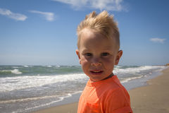 Cute baby boy playing with beach toys Royalty Free Stock Image