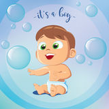 Cute Baby Boy Playing Bubbles. It`s A Boy. Happy birthday. Little boy sitting on floor Stock Images